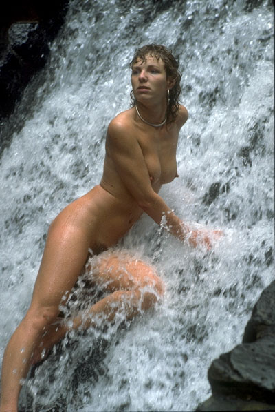 16347-Hot-lady-at-the-waterfall-enjoying-the-water Hot lady at the waterfall enjoying the water