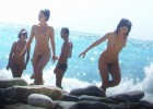 Many girls having fun naked on the beach