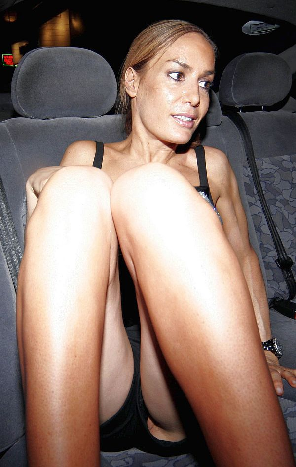 Beautiful chick reveals a part of her pussy on the backseat of the car