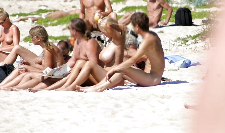 Horny babes at the beach expose their boobies