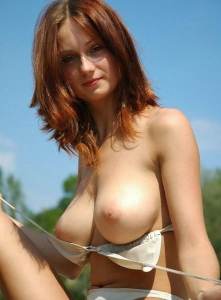 129-Hot-mature-ginger-taking-her-top-off Hot mature ginger taking her top off
