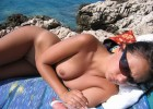 130-thumb-Hot-girl-with-sunglasses-exposed-nude Nude girl exposed by voyeurs walking on the beach