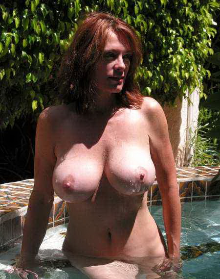 Busty beautiful babe exposed in her private pool