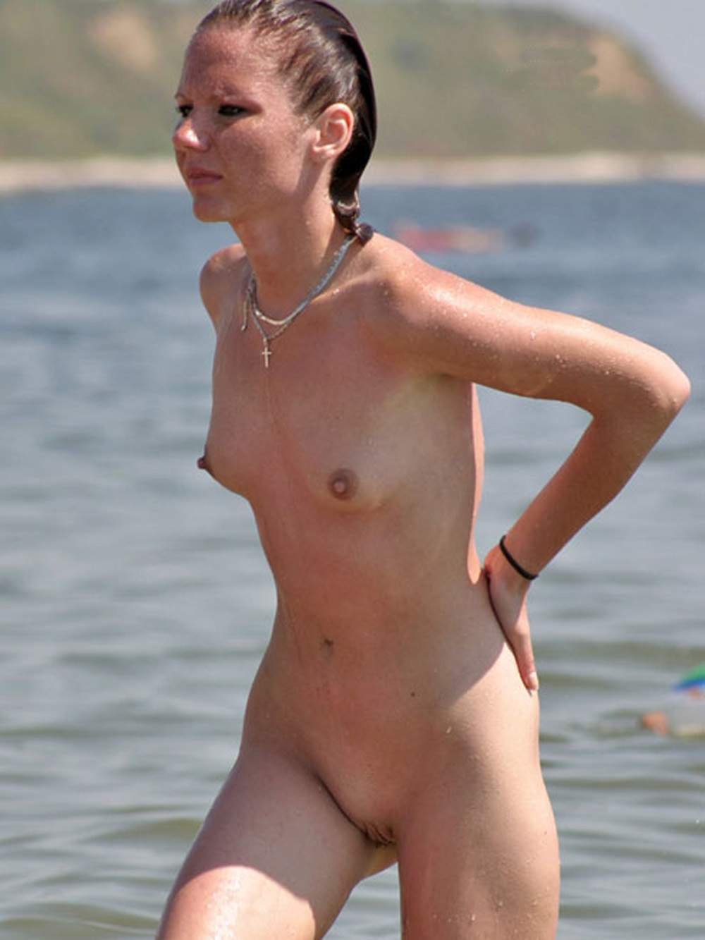 Freckled nude beauty exit from the water to delight us