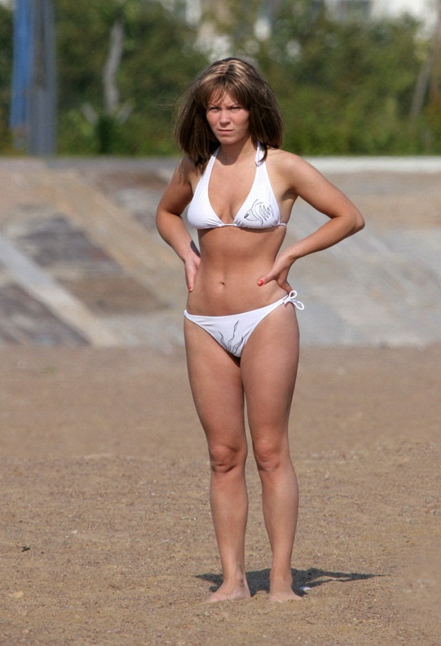 Hot wife exposed on the beach wearing white bikinis