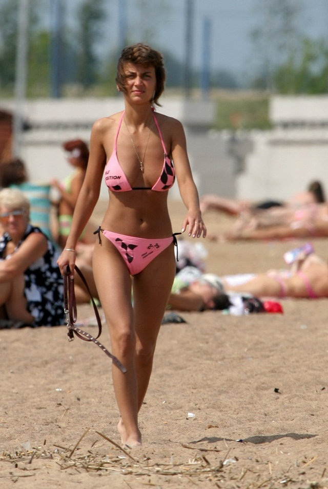 221-Pink-bikinis-babe-walking-through-the-hot-sand Pink bikinis babe walking through the hot sand