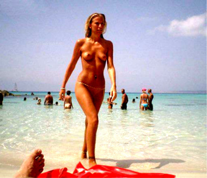 Skinny tall sexy babe walking topless from the water