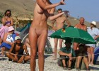326-thumb-Tanned-woman-shows-off-shaved-pussy-for-crowd Two girls show off their breasts for the camera