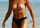 341-thumb-Topless-hottie-caught-by-voyeur-camera-while-exits-from-sea Beach voyeur caught this pretty lady tanning her butt