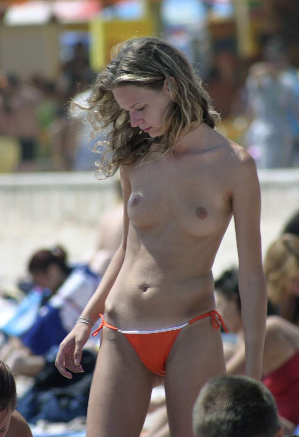 Topless sweetie exposed by beach pervs